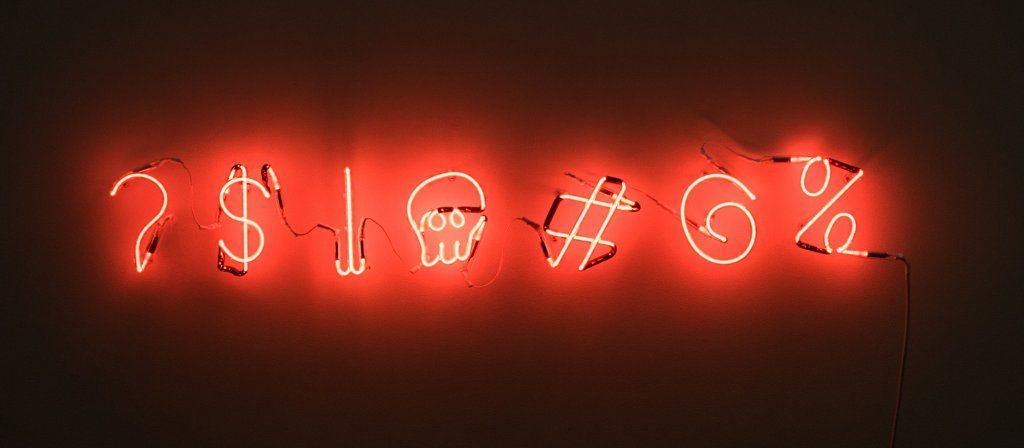 neon sign angry symbols